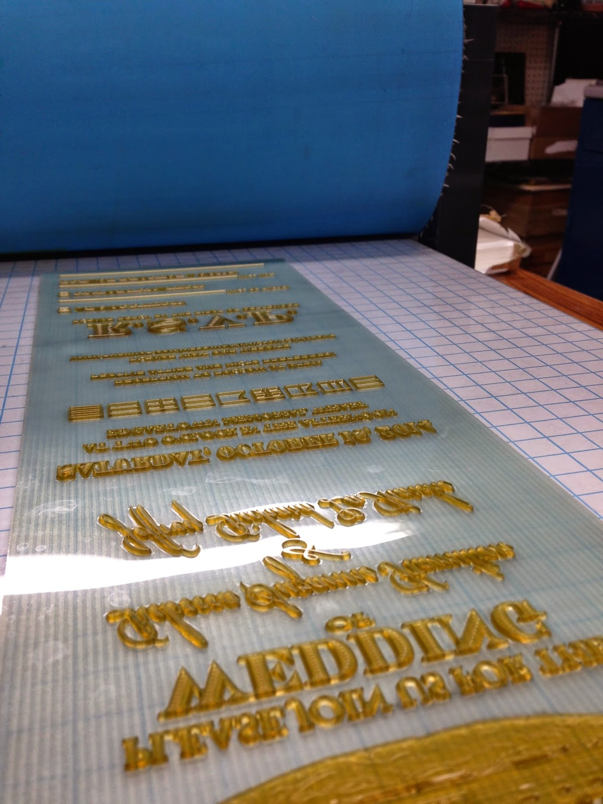 Here is the plate on press ready to go! We used the Conrad etching press due to the plates long odd size and to get the desired deep impression.