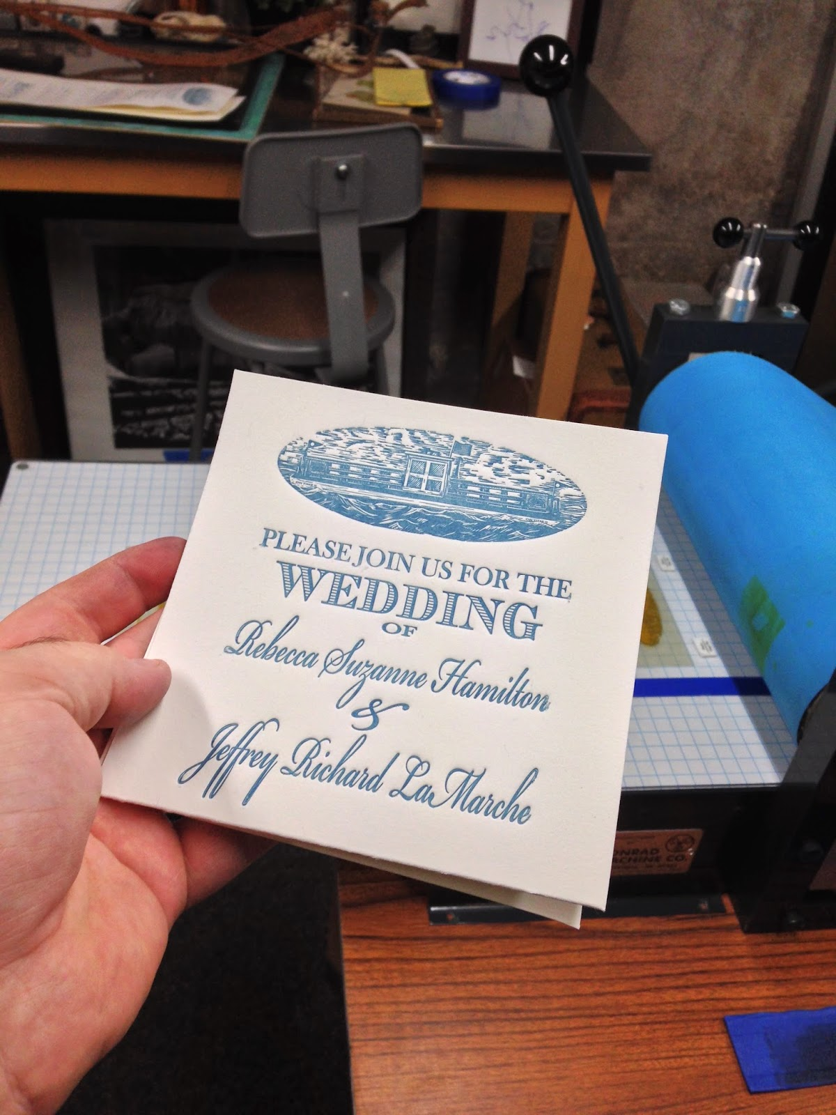 A look at the invite folded as it would slide out of its envelope.