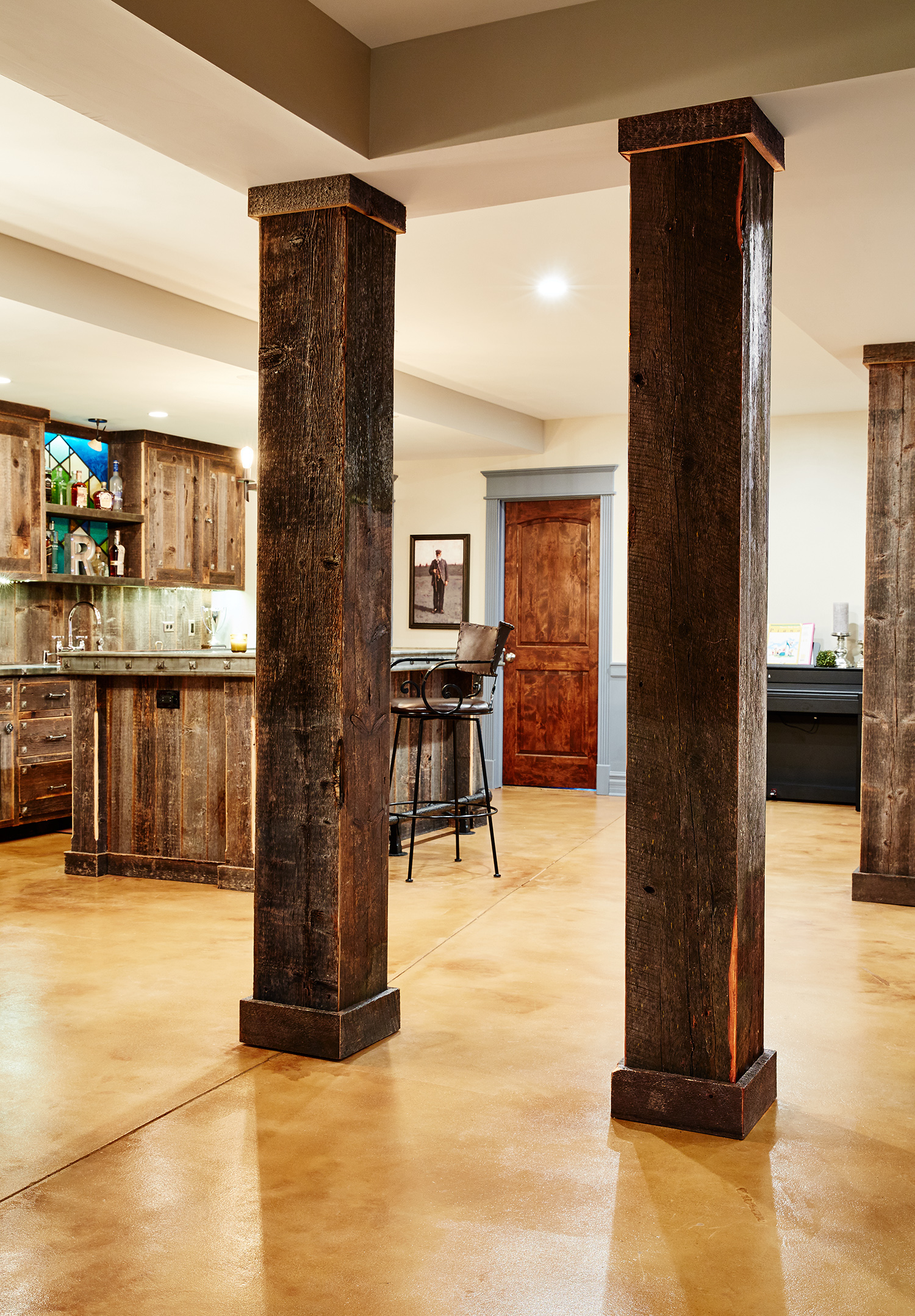 Matching Reclaimed Wood Paneling on Basement Beams