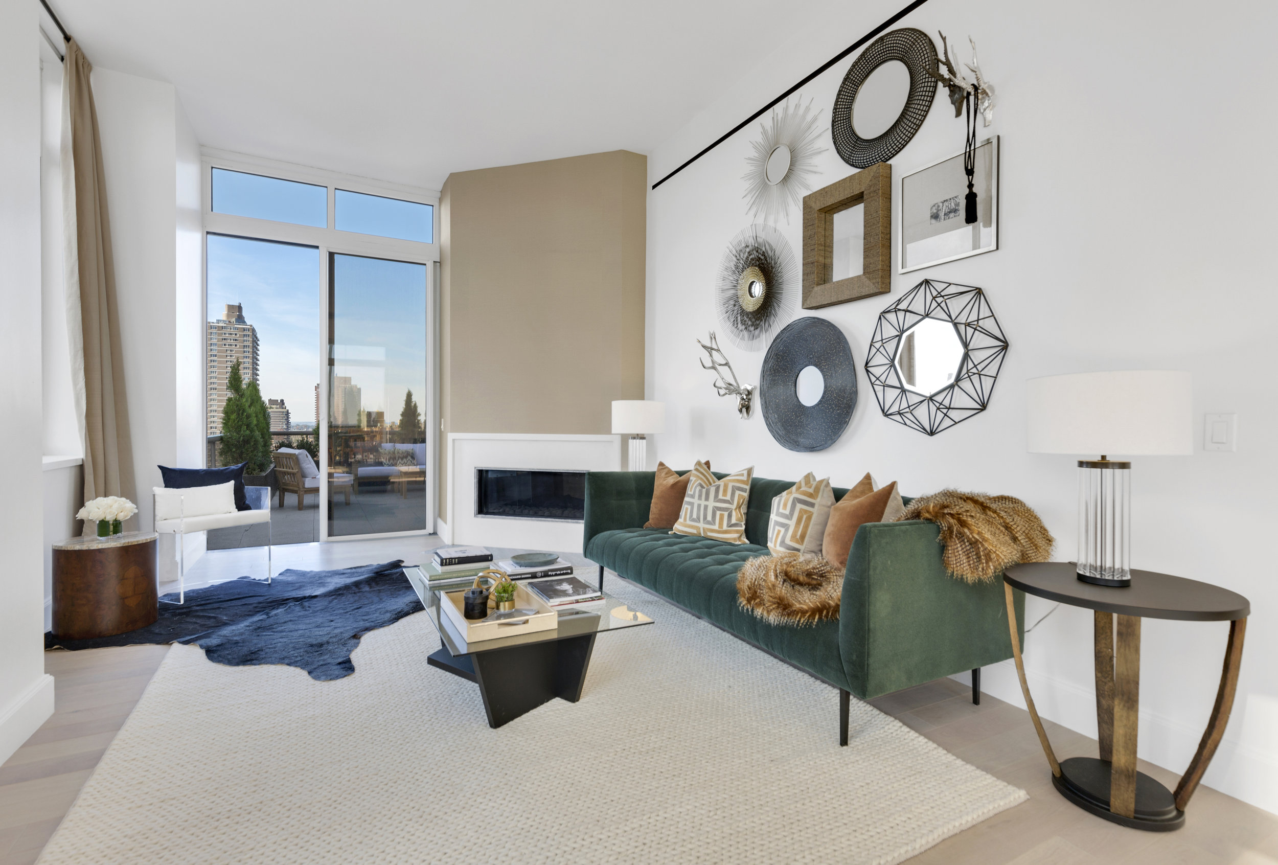 A profound green sofa to support the southwestern theme was chosen for this penthouse on the Upper East Side.