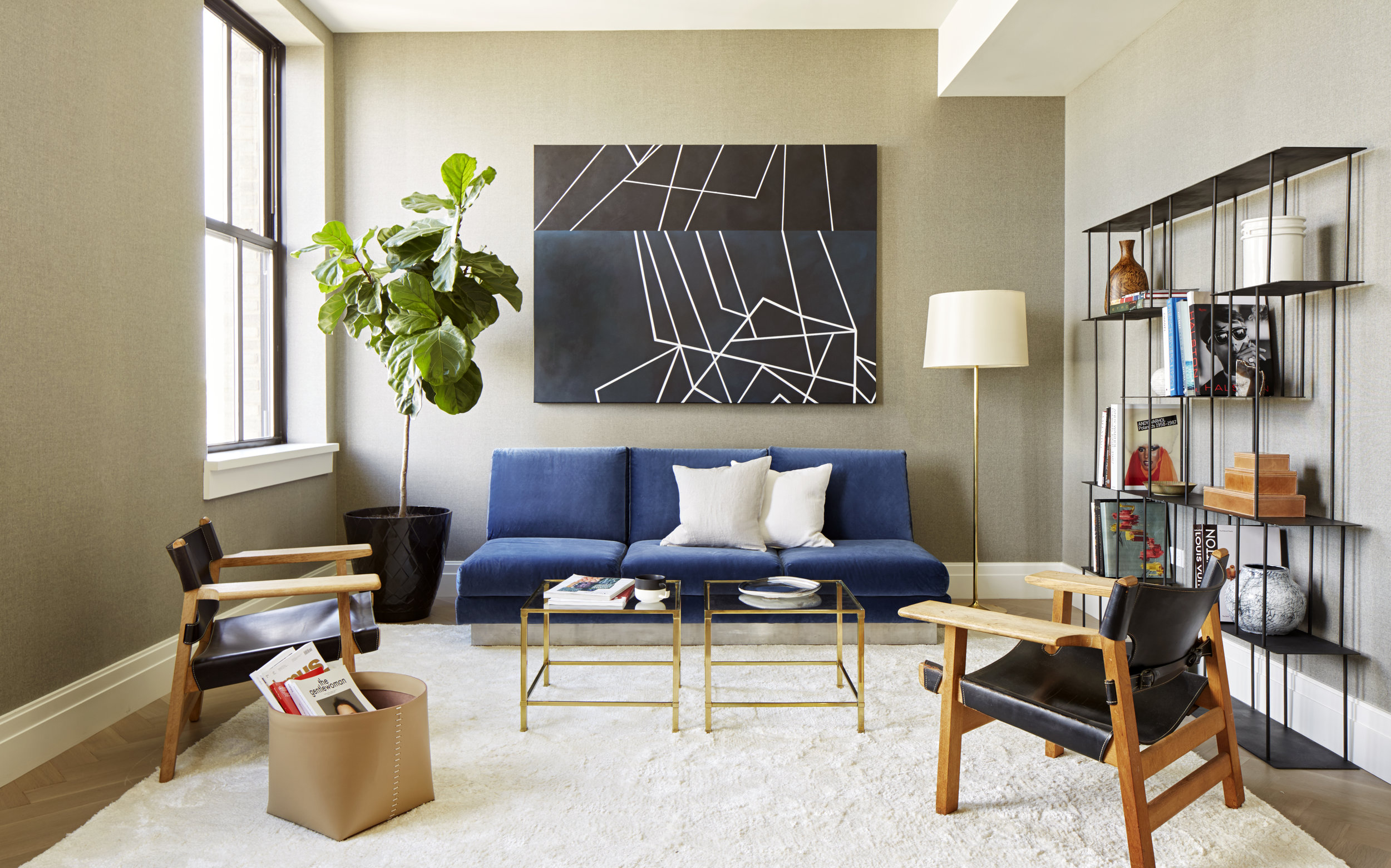 In harmony with the color choice, placing the sofa centered to the room creates a baseline for the rest of this sophisticated living space in TriBeCa.