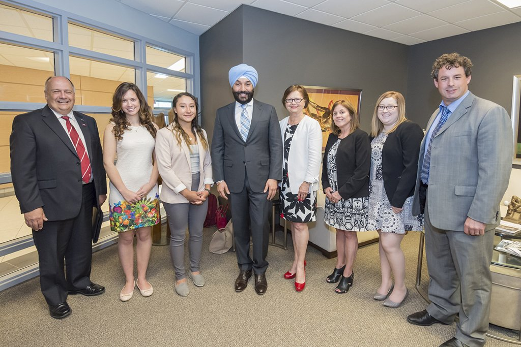 Ministers Bains and Foote with member of Memorial University's Enactus team, recently crowned national champions.