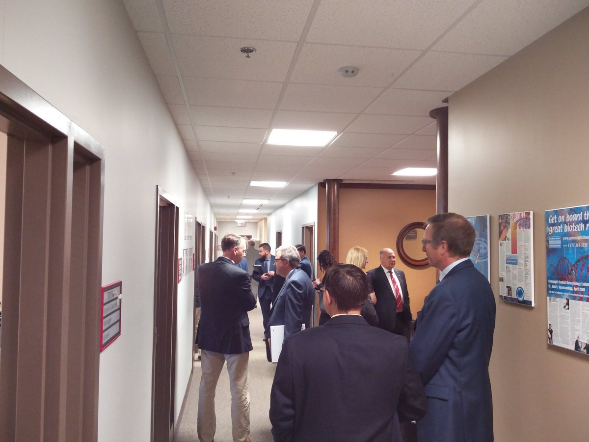The large group of government officials, photographers, and our staff touring Genesis.