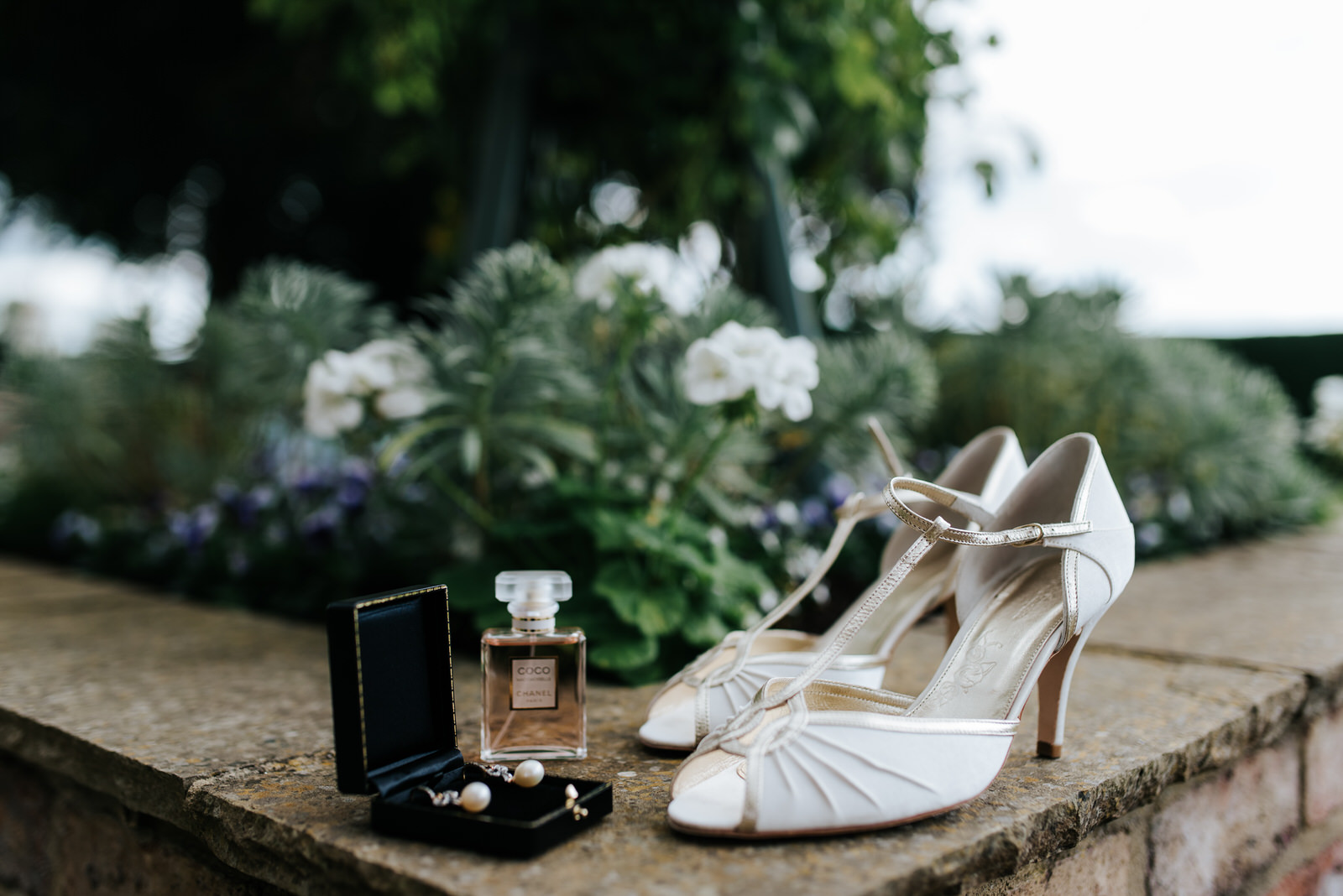 Wedding shoes and details in garden