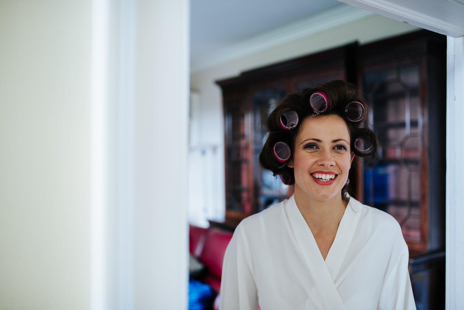 Bride looks fabulous as she gets her hair ready
