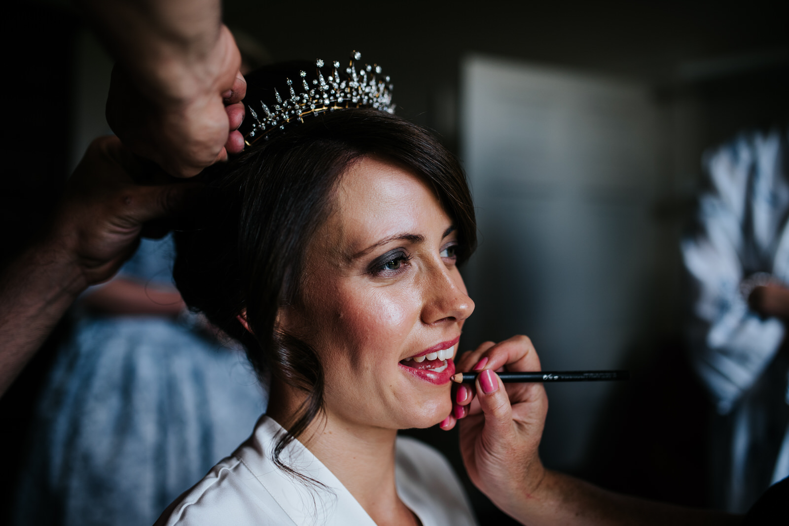 Bride looking glamorous as makeup is applied to her lips