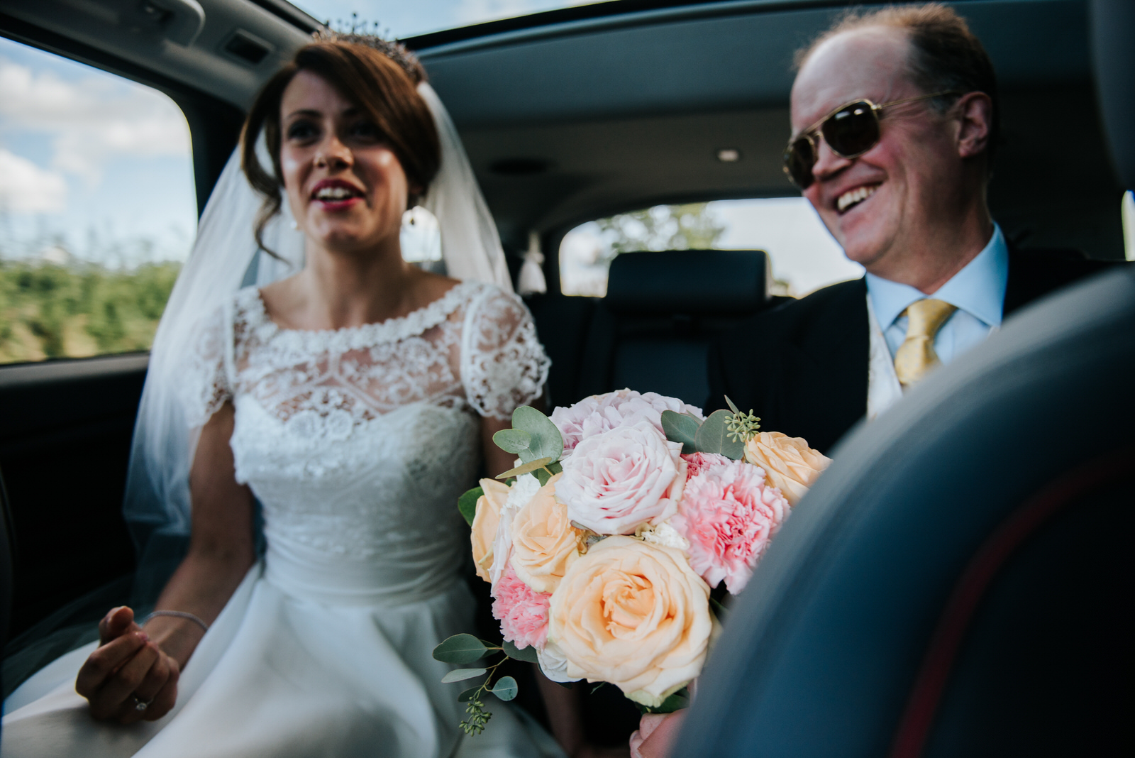 Bride and father of the bride nervous on their way to the Church