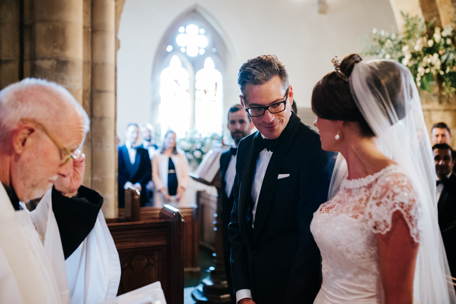 Grooms sees Bride inside Church for the first time and smiles