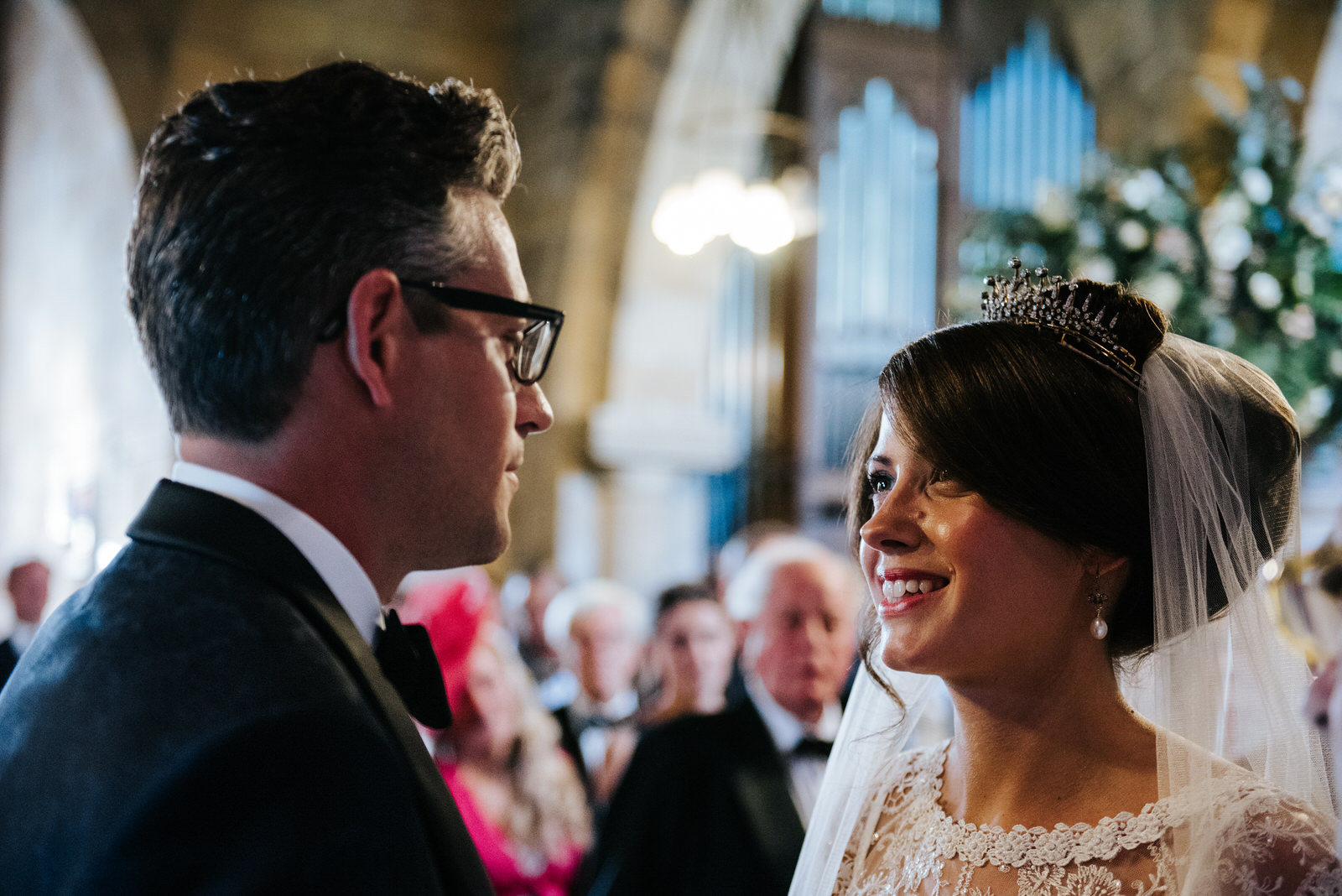 Bride looks into Grooms eyes and smiles cheek to cheek inside Ch