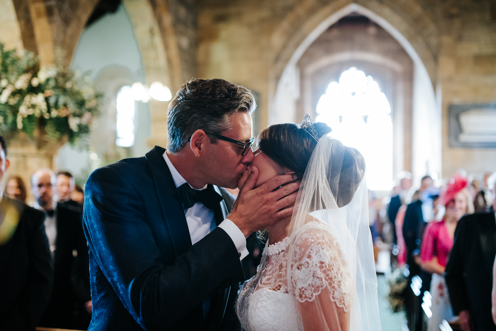 Bride and Groom first kiss inside Felixkirk Church in Yorkshire