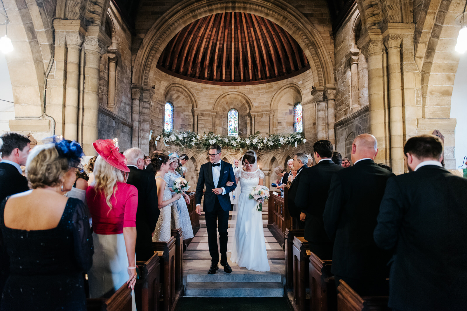 Bride and Groom exit down the aisle of Felixkirk Church