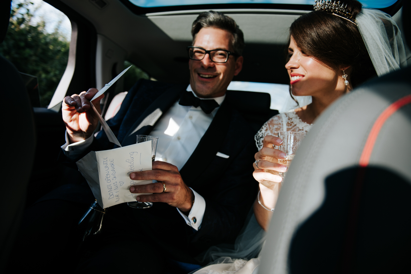 Groom opens letter that Bride wrote to him