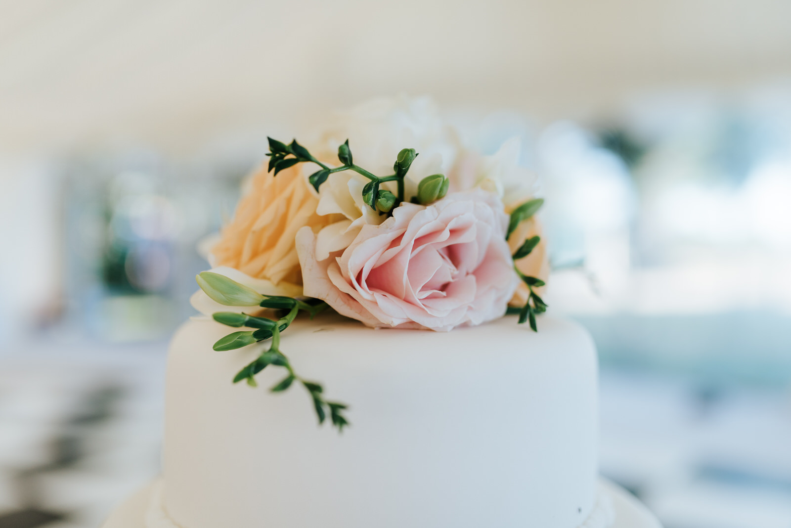Close-up of wedding cake topper designed by Twinkling Twine