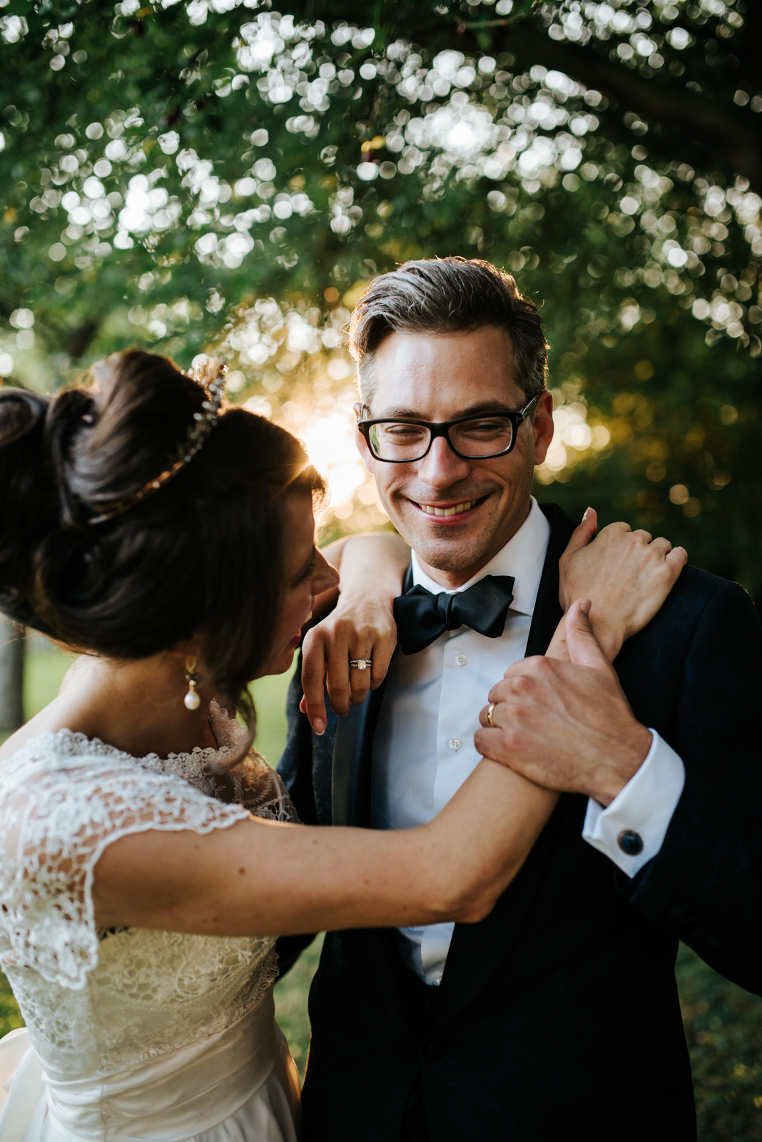Bride and Groom laugh at each other during couple photos in magn
