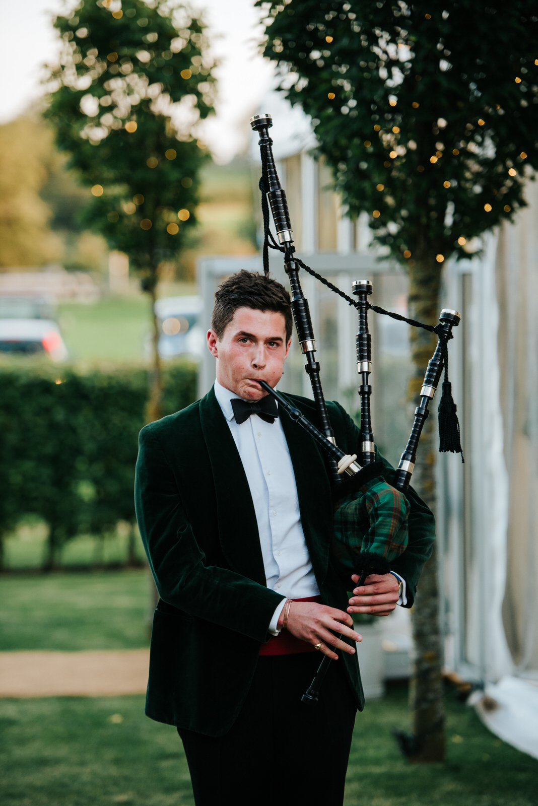 Bagpipe Player ushers guests into the Garden Marquee