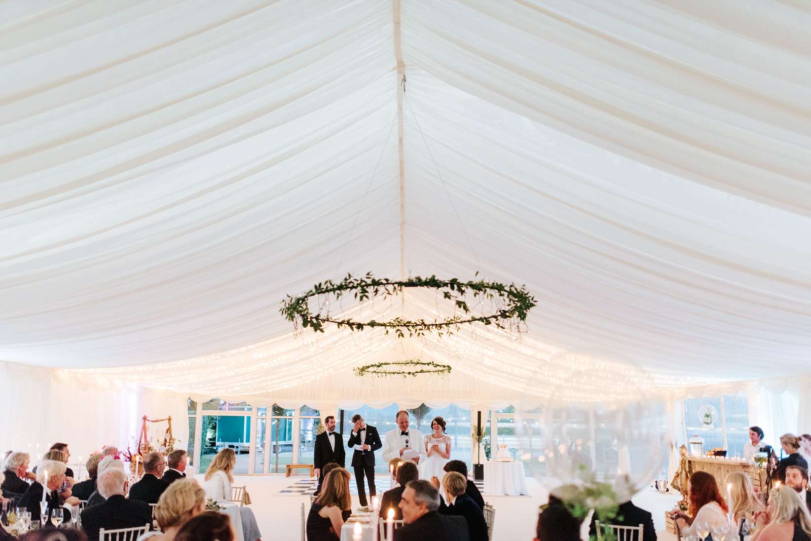 Wide shot of beautiful garden marquee in Yorkshire as speeches a