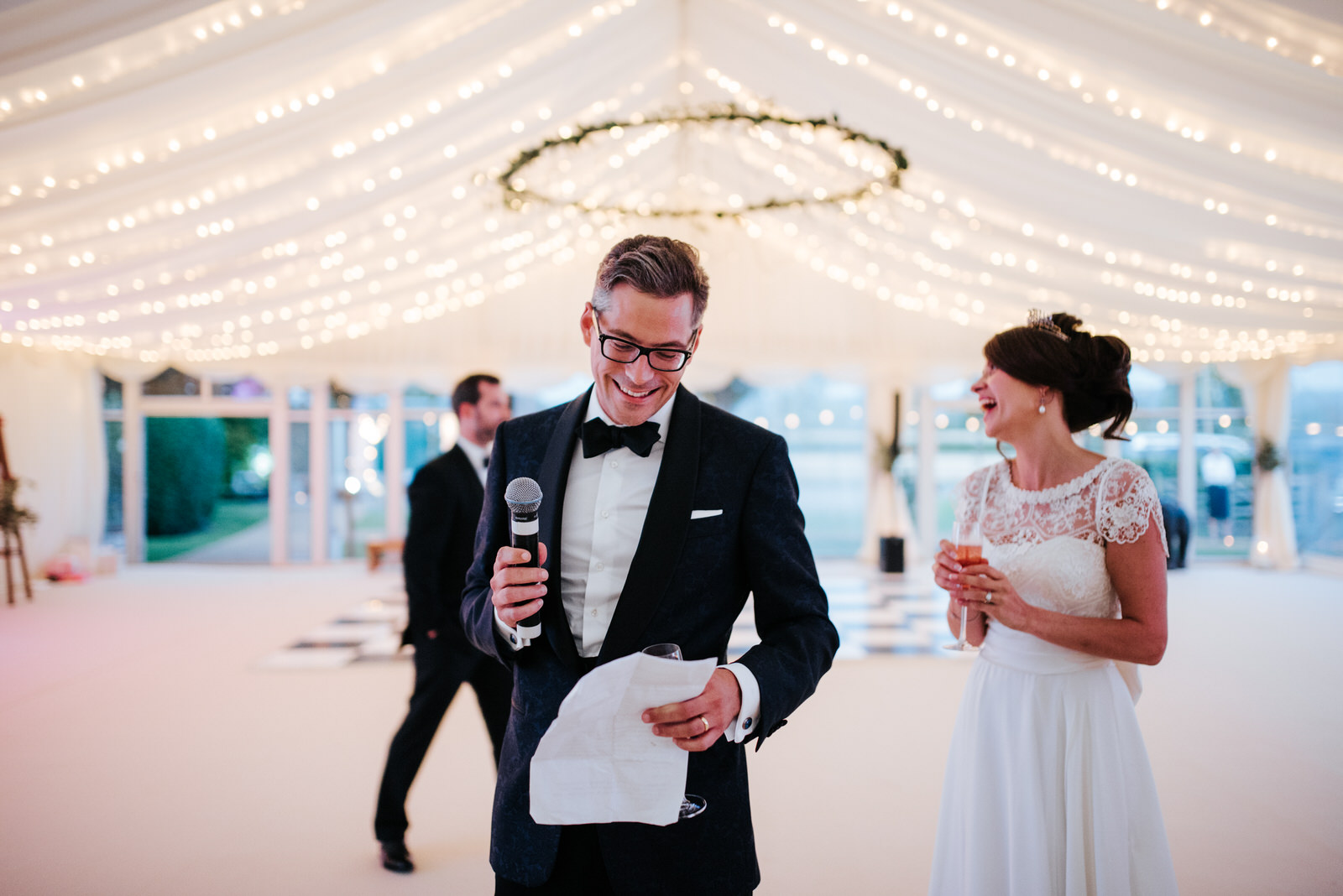 Groom smiles as he is about to begin his speech inside Marquee