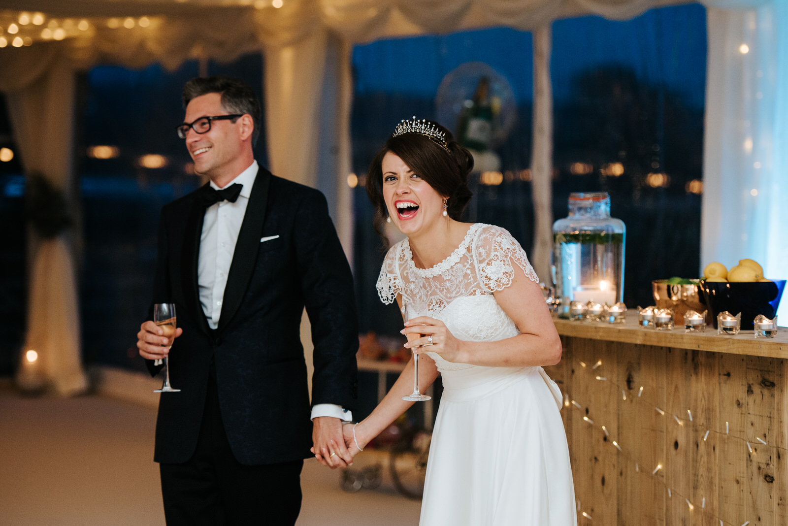 Bride laughs as other speeches are delivered