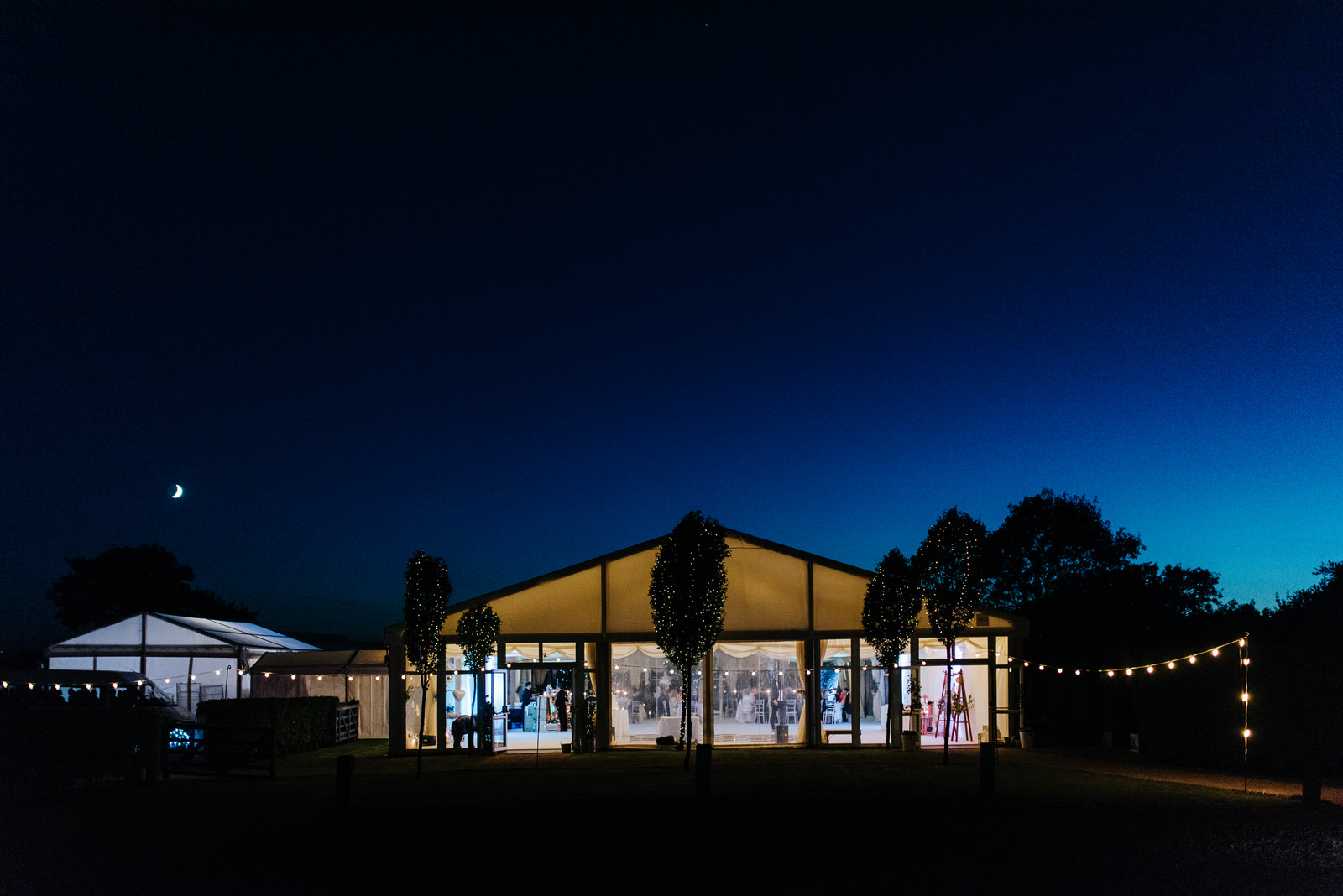 Exterior photo of wedding marquee in Yorkshire as moon rises and