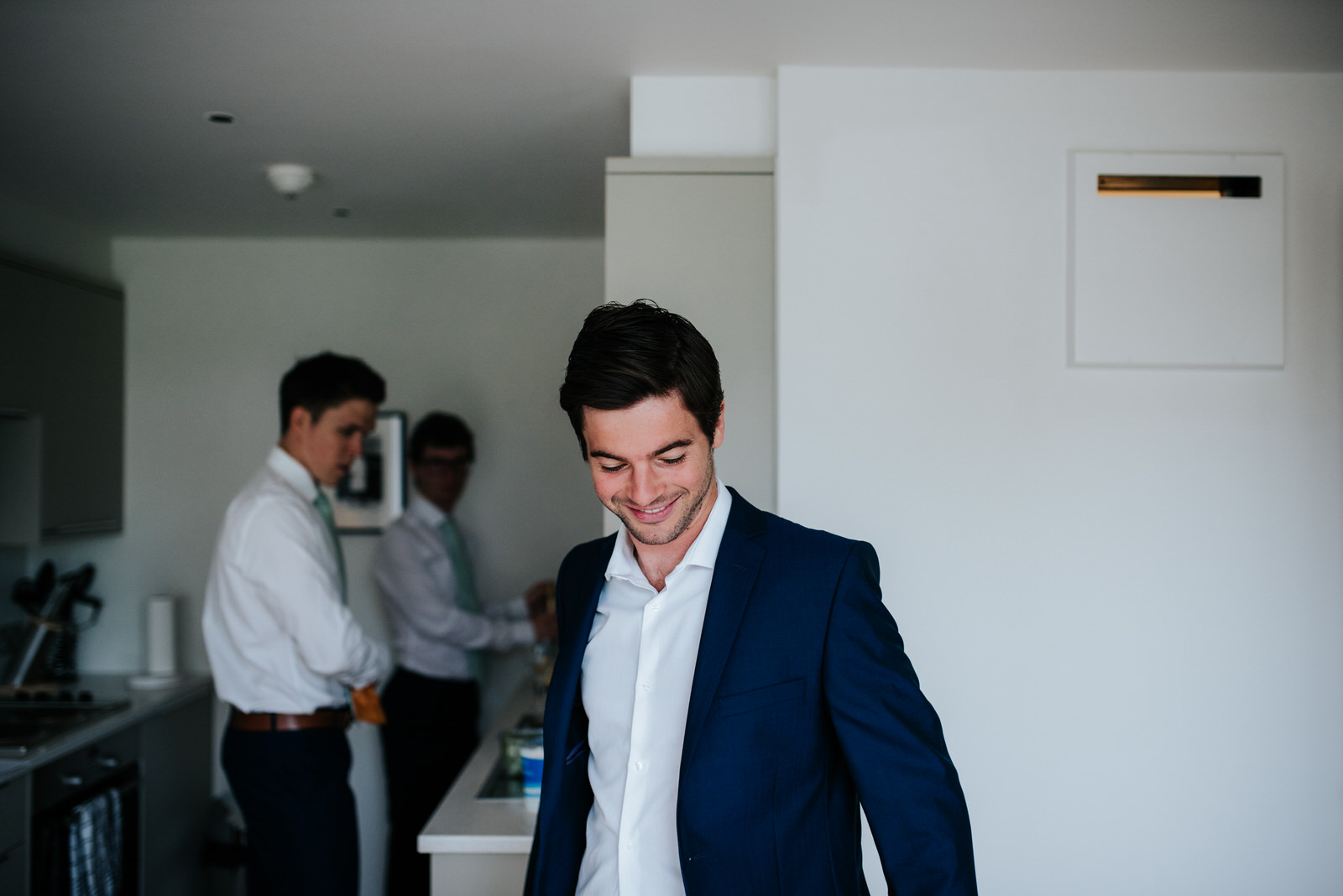 Groom reflects about the day as he gets ready in front of grooms