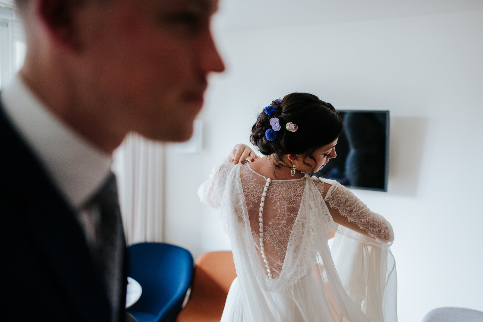 Bride looks at the back of her dress