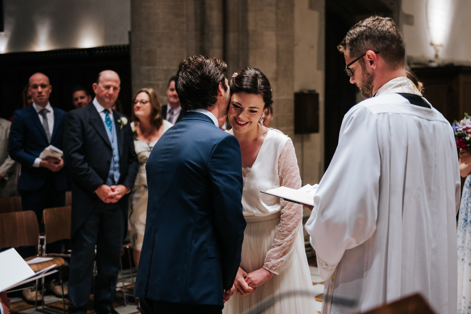 Groom embraces his Bride at the altar in Jesus College Chapel, C