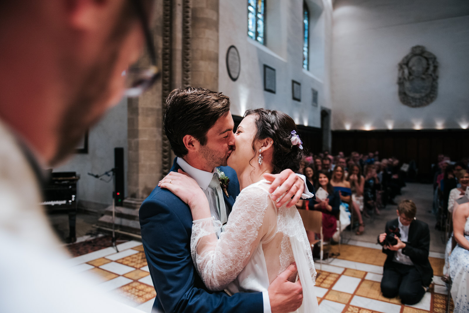 Bride and groom first kiss during wedding ceremony at Jesus Coll