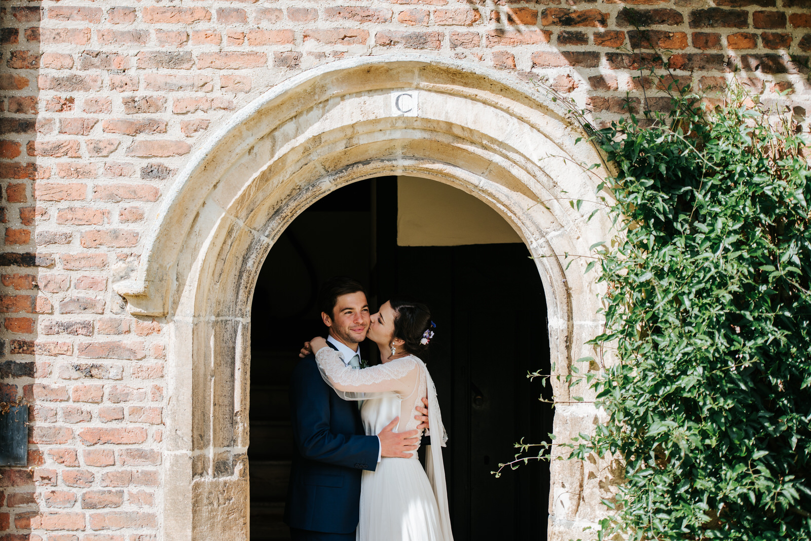 Bride and groom embrace each other romantically during wedding c