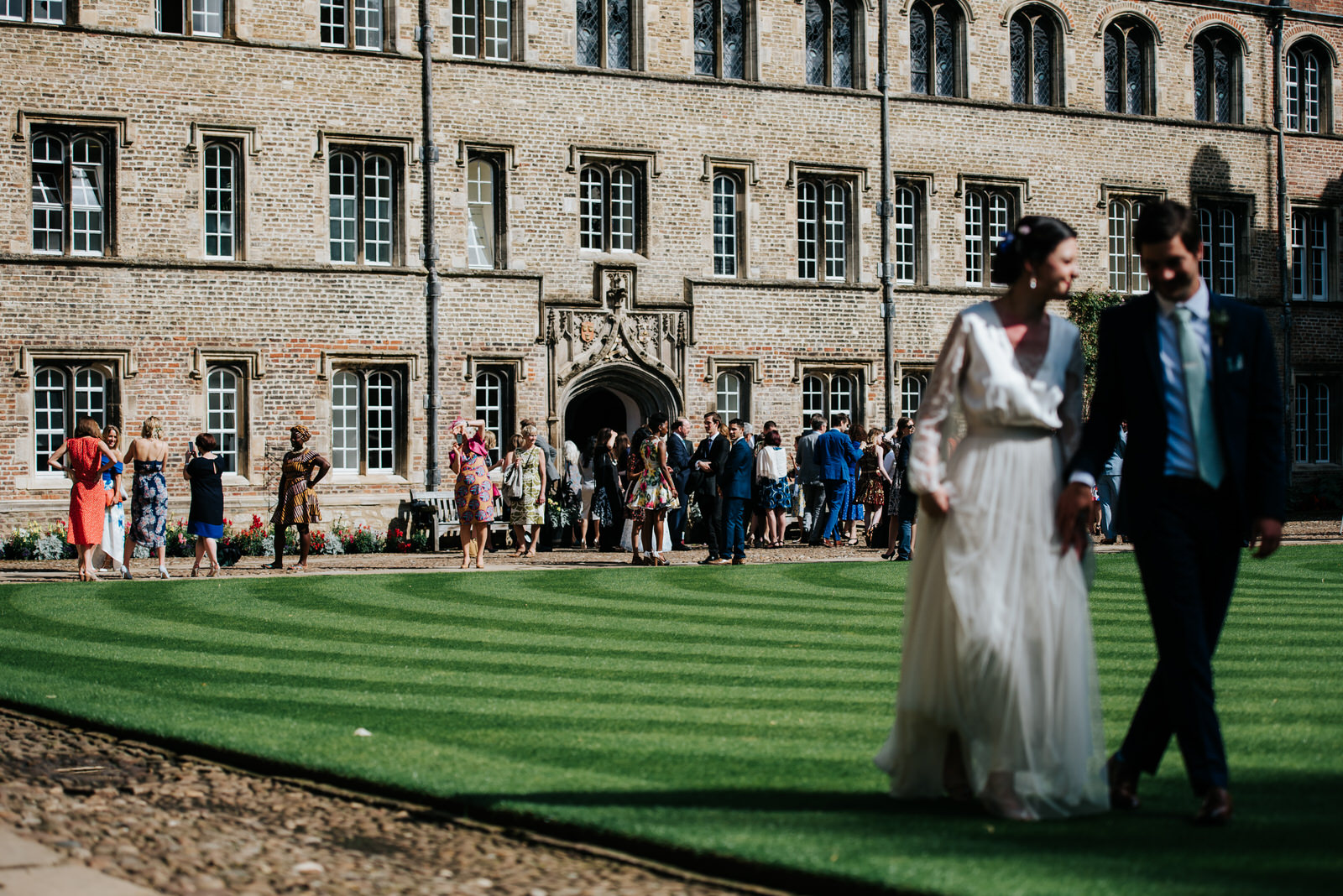 Bride and groom look towards guests as they enjoy themselves on