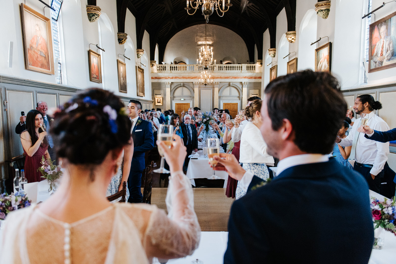 Guests raise a toast to the new bride and groom after father of
