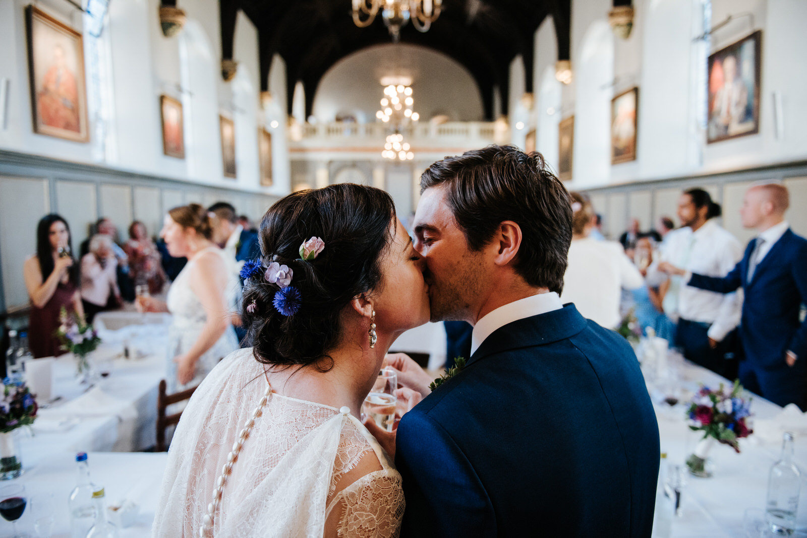 Bride and groom kiss after wedding speeches