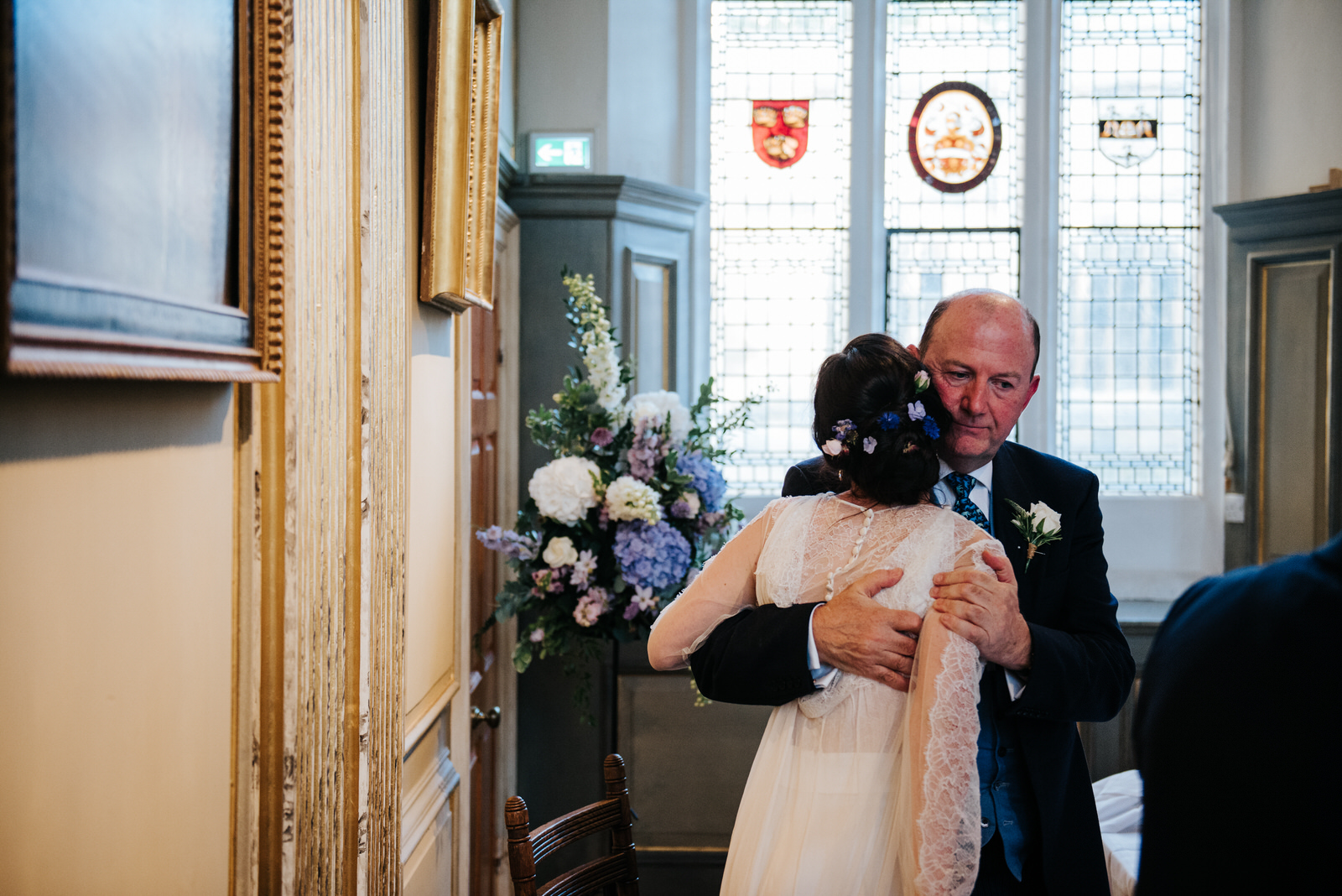 Bride hugs her father as she finishes her wedding speech