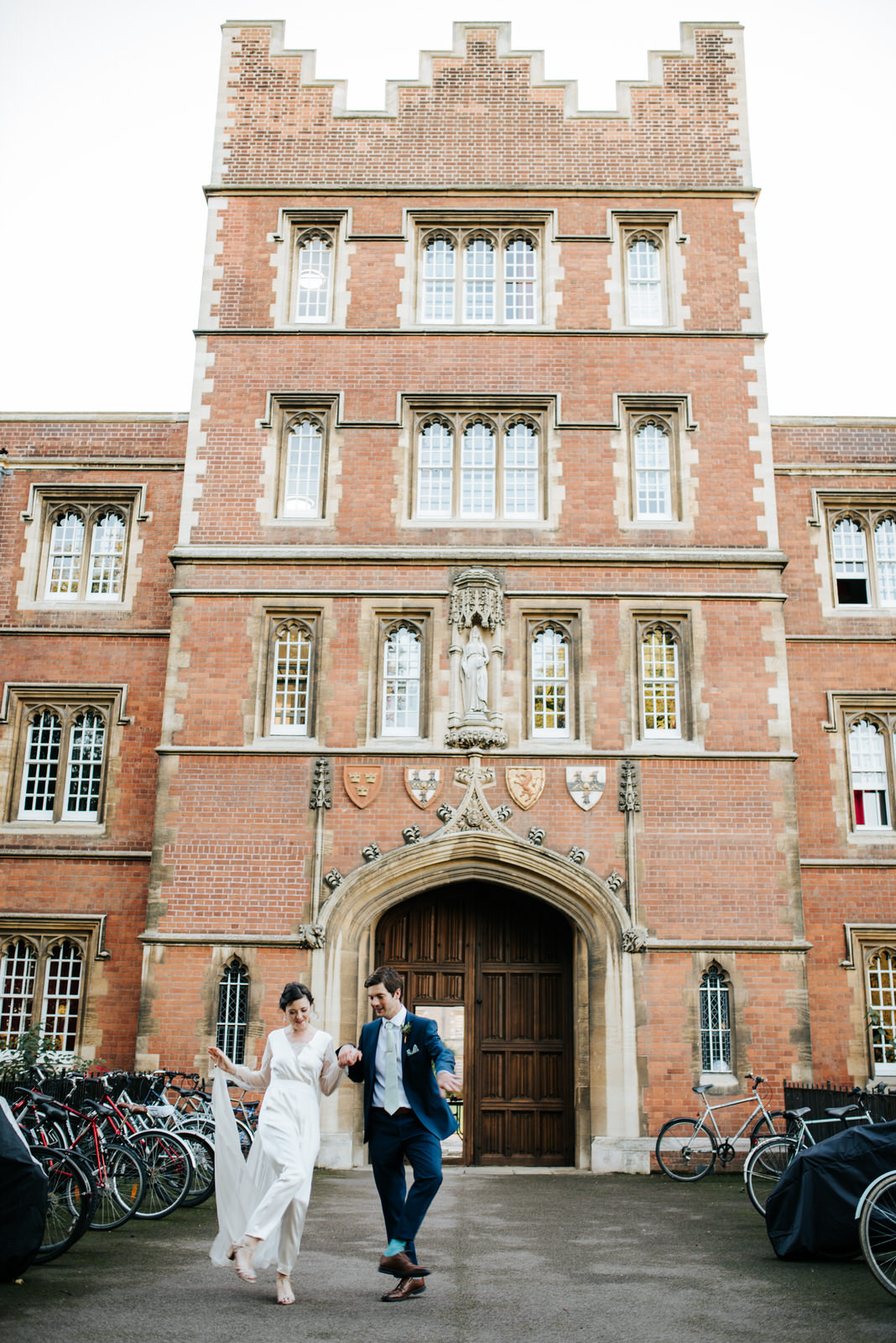 Bride and Groome exit Jesus College Chapel Court as they dance