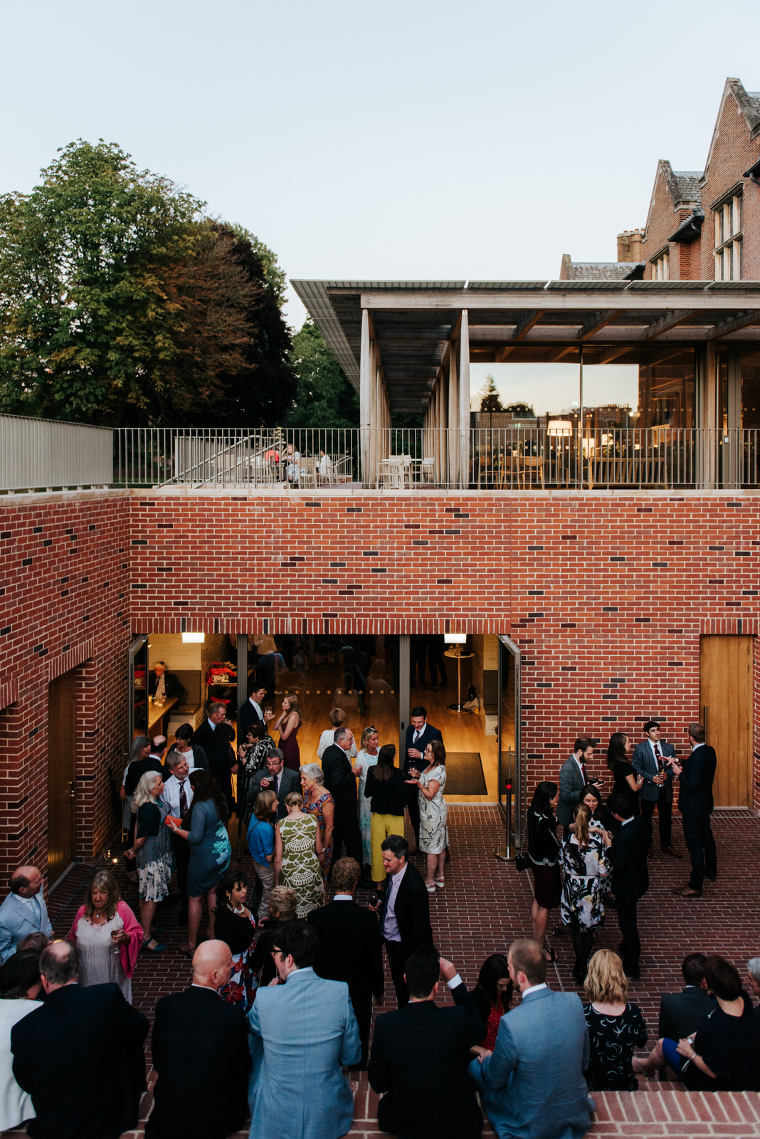 Guests enjoy the evening party at Jesus College Roost Bar in Cam