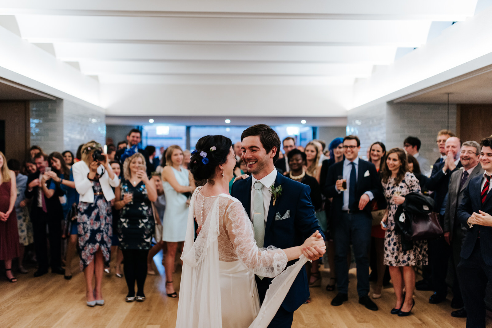 Bride and groom have their first dance in front of guests at Wes