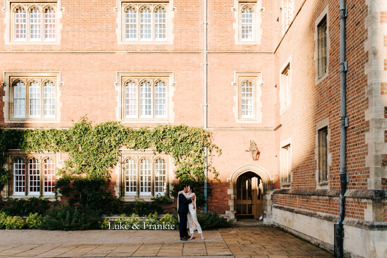 Bride and groom embrace each other in front of Chapel Court at Jesus College in Cambridge