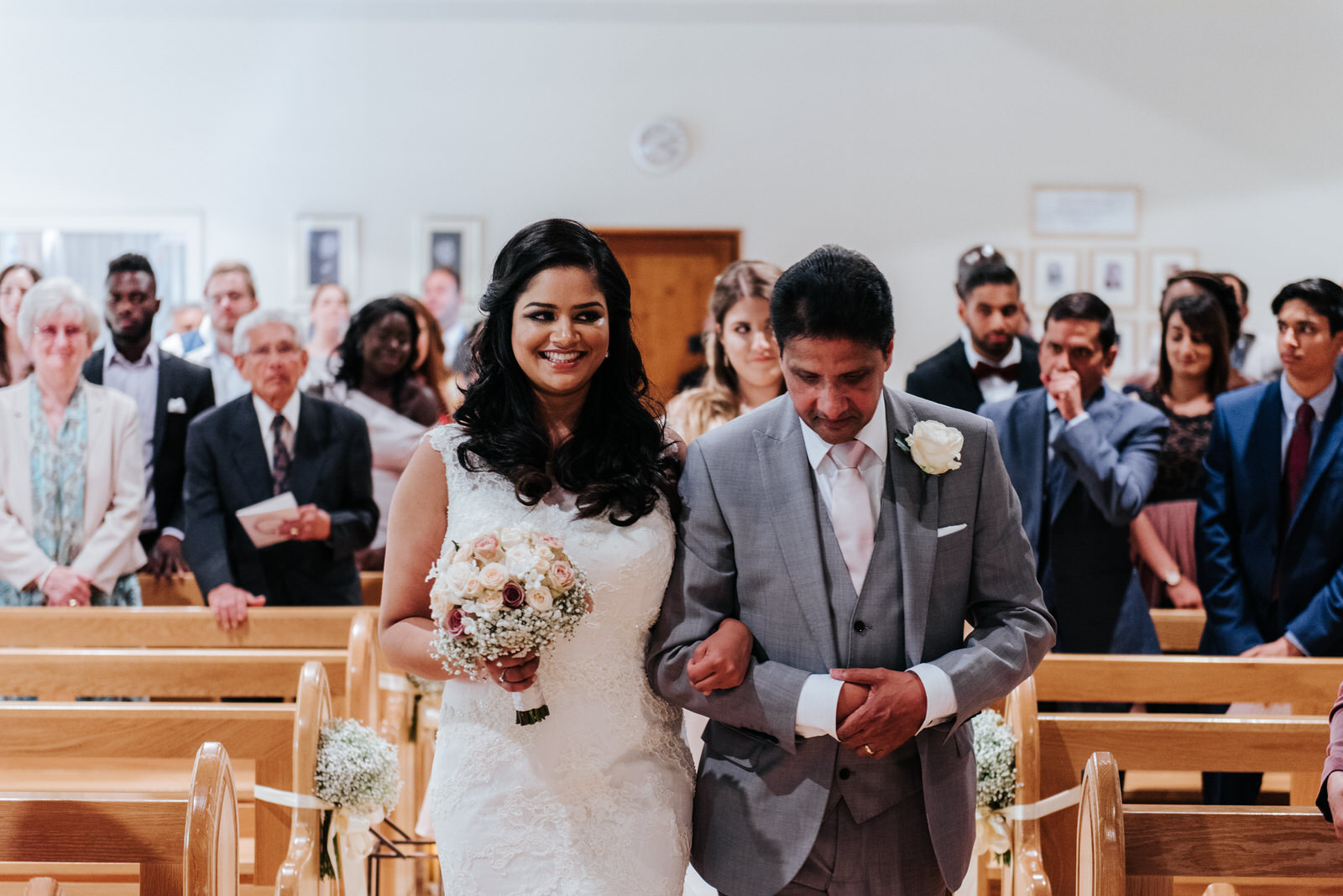 Bride and father of the bride walk down the aisle at Woldingham