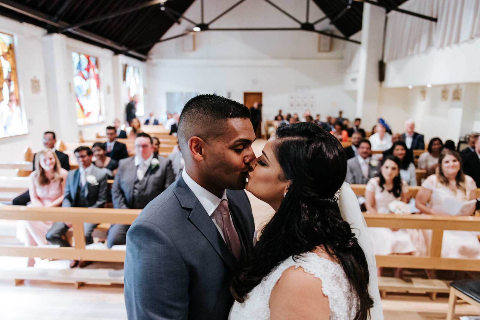 Bride and groom have first kiss during ceremony