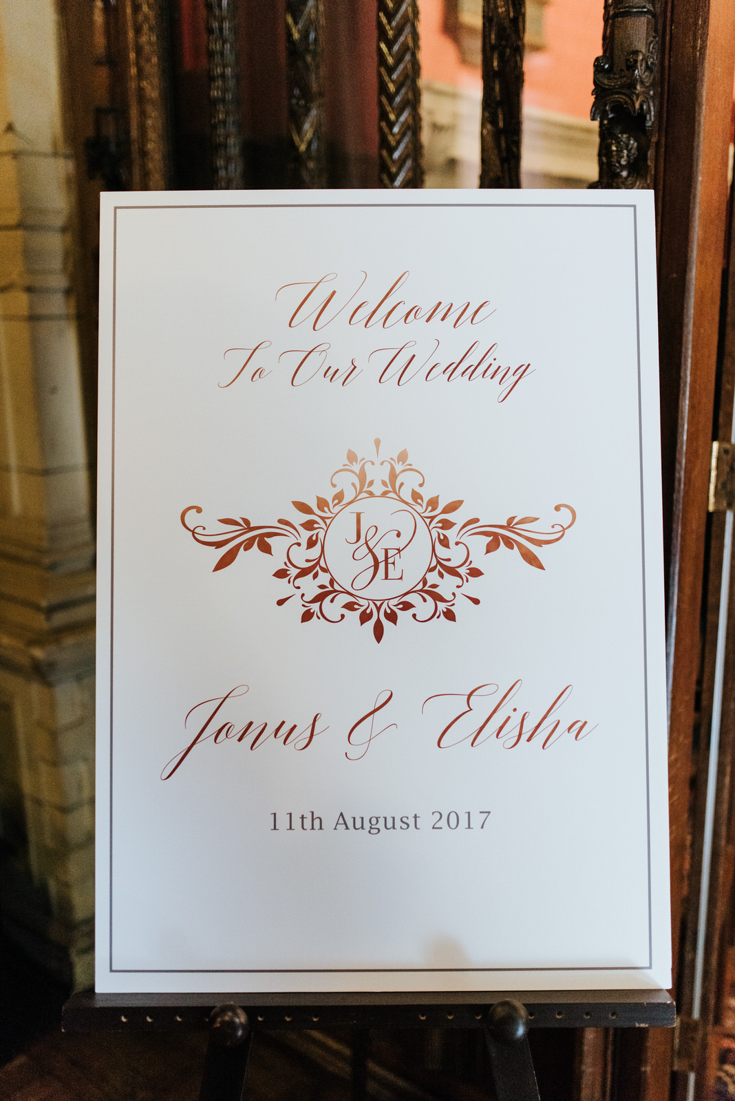 Photograph of wedding details showing the couples' names and the