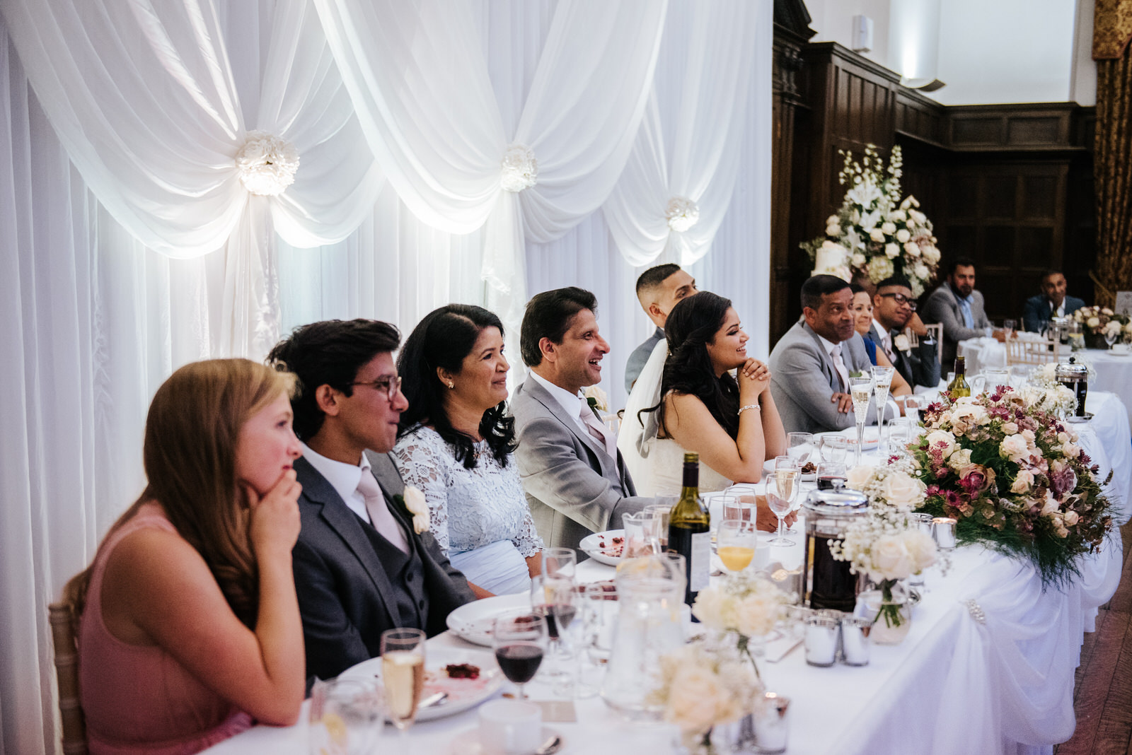 Head table looks at maid of honor delivering her speech