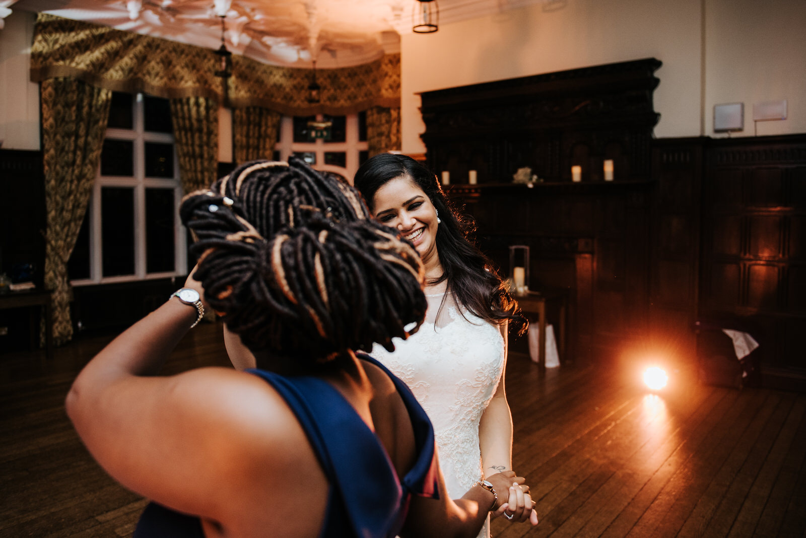 Bride dances with guest after first dance