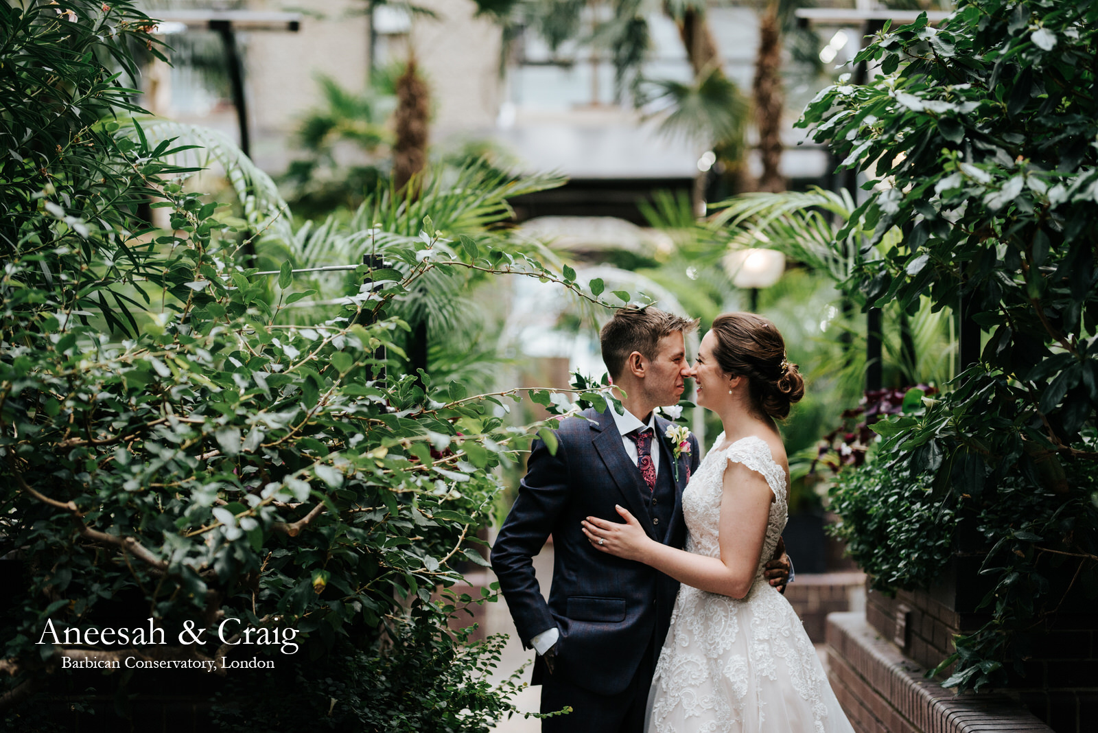 Cute photograph of bride and groom touching noses and smiling