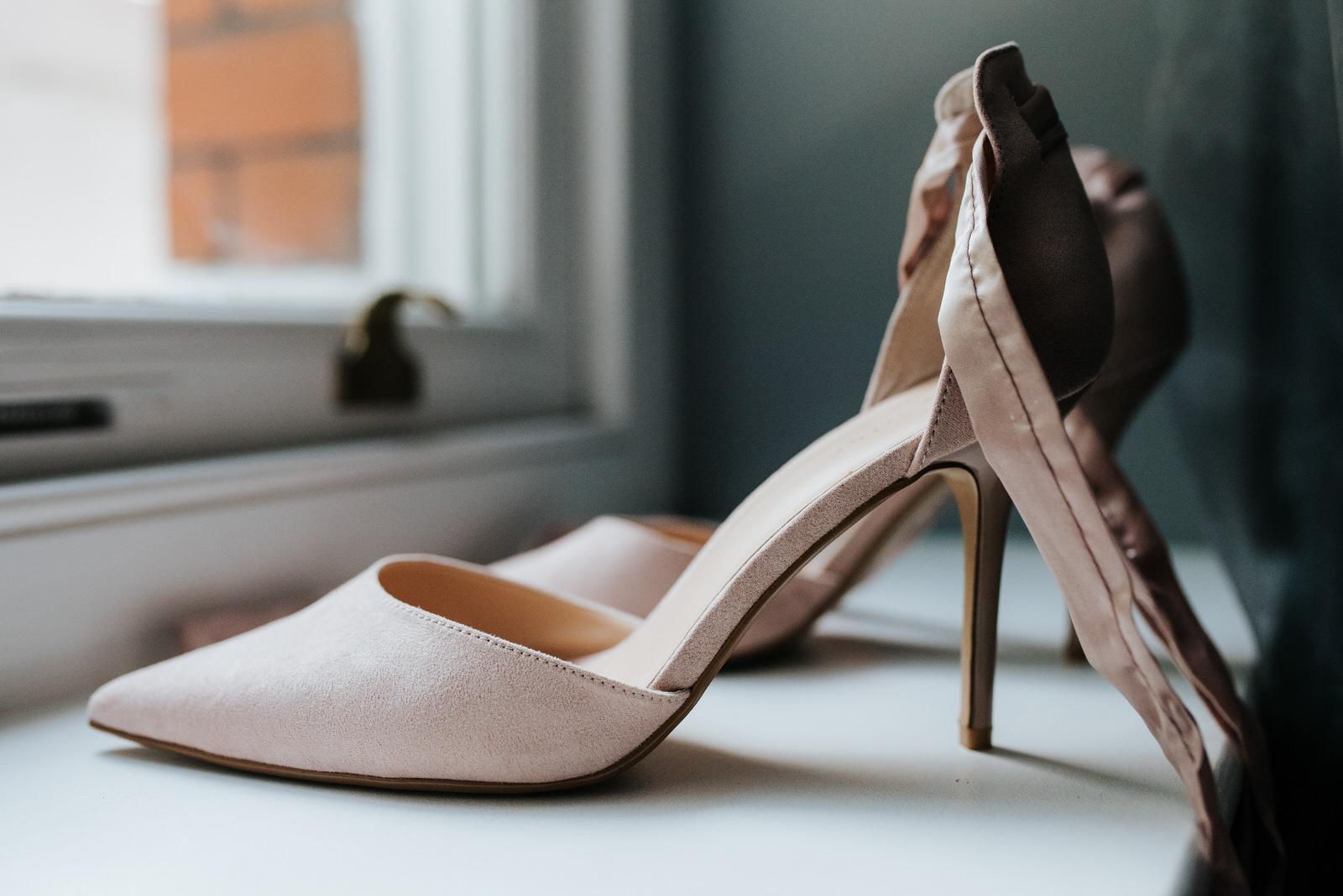 Baby pink bridal shoes detail shot