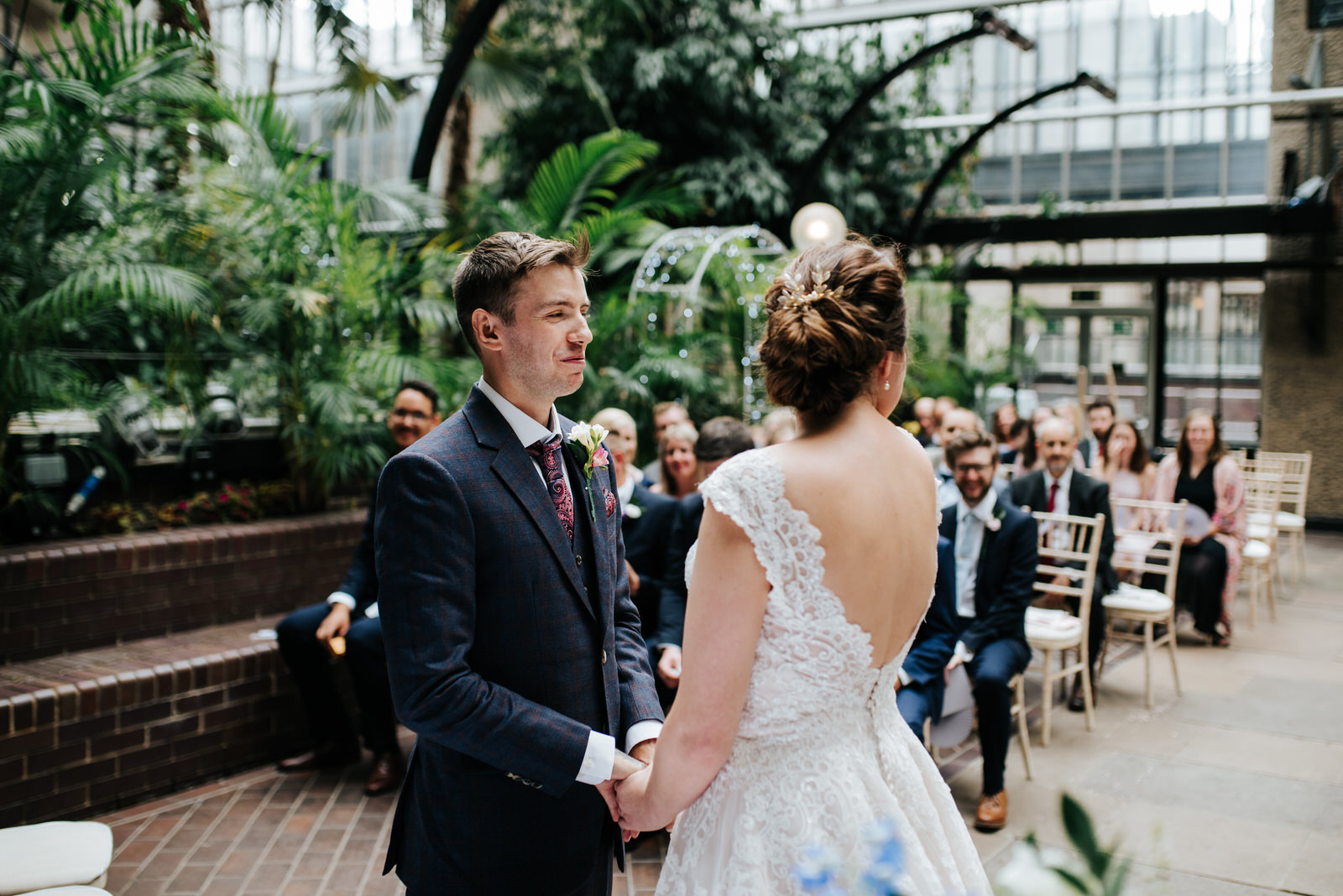 Groom reacts to seeing bride for the first time by holding hands