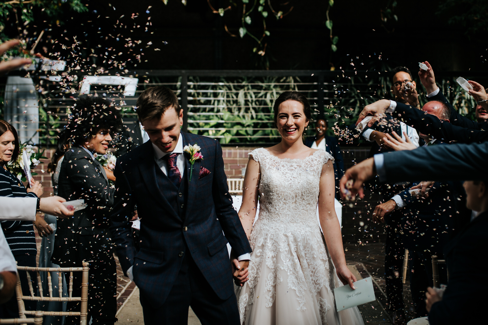 Bride and groom exit down the aisle as husband and wife as guest