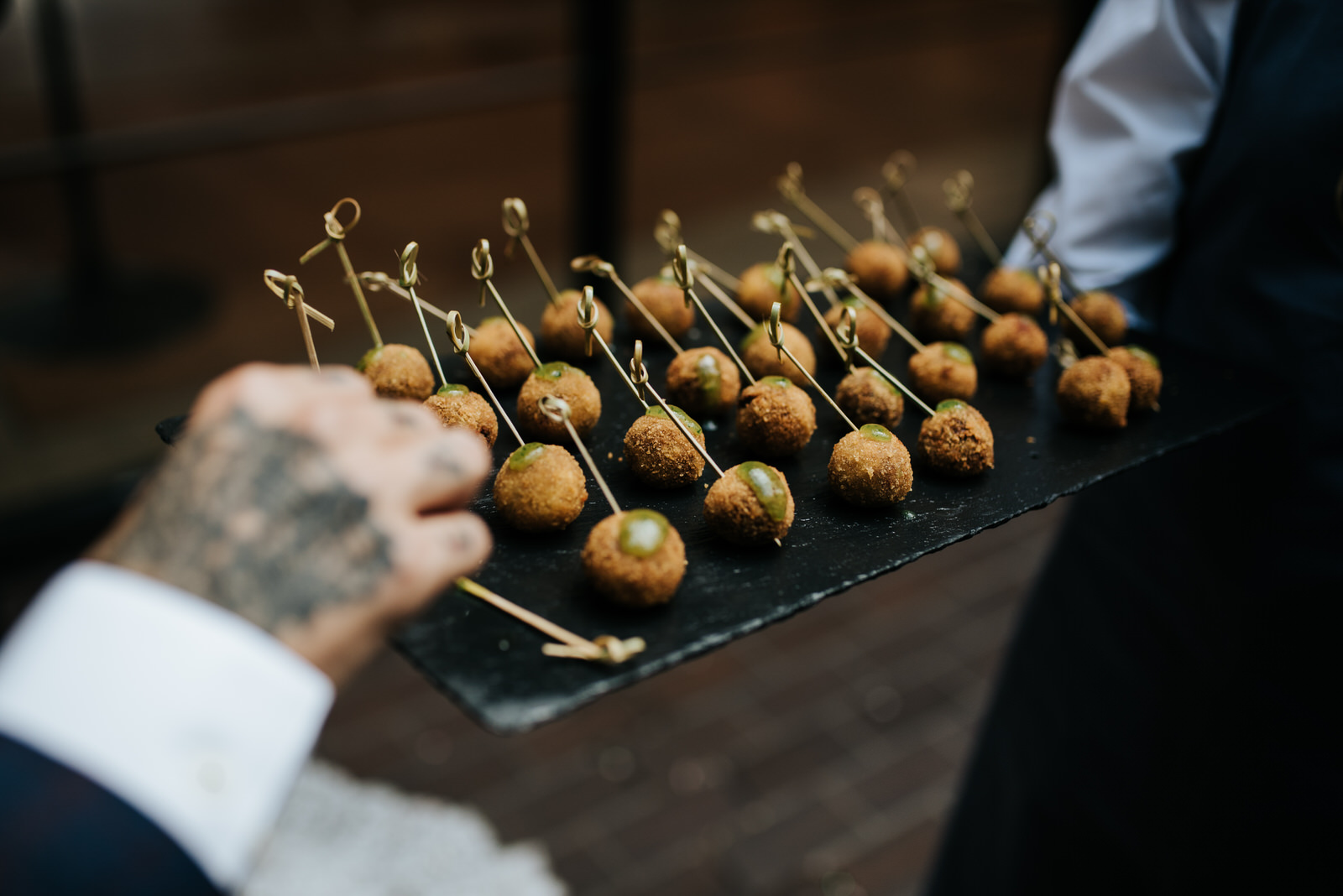 Close up of canapes while guest takes one