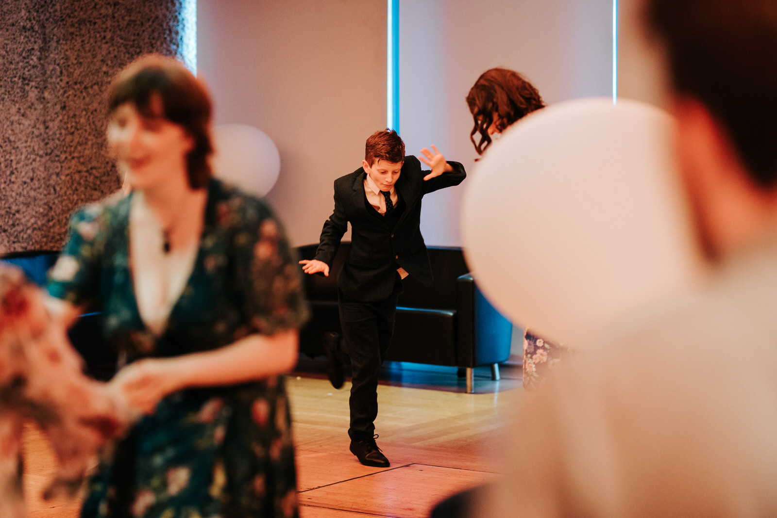Young guest performs cool dance move as the party begins