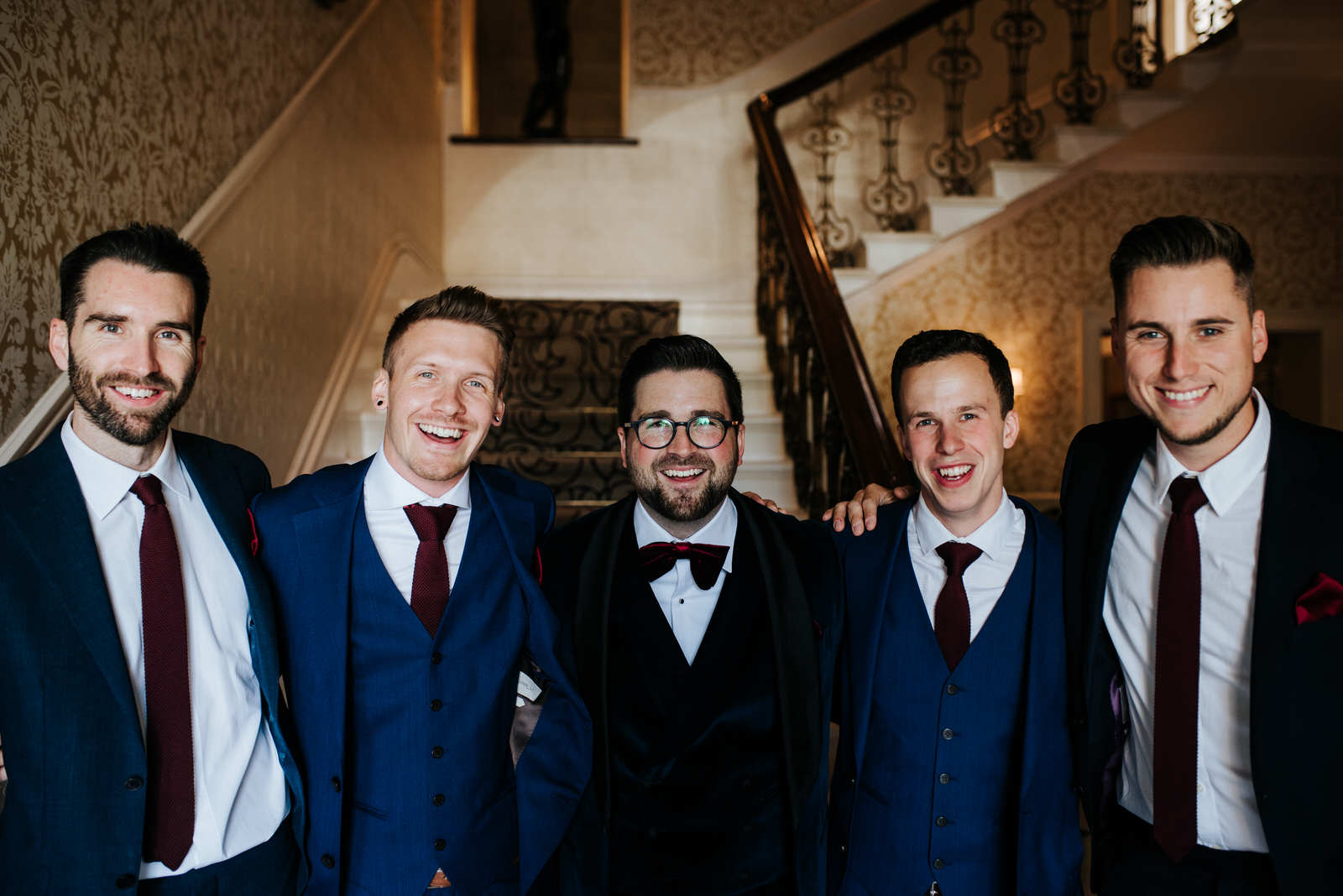 Group-shot of groom and groomsmen as they prepare to leave The Petersham hotel