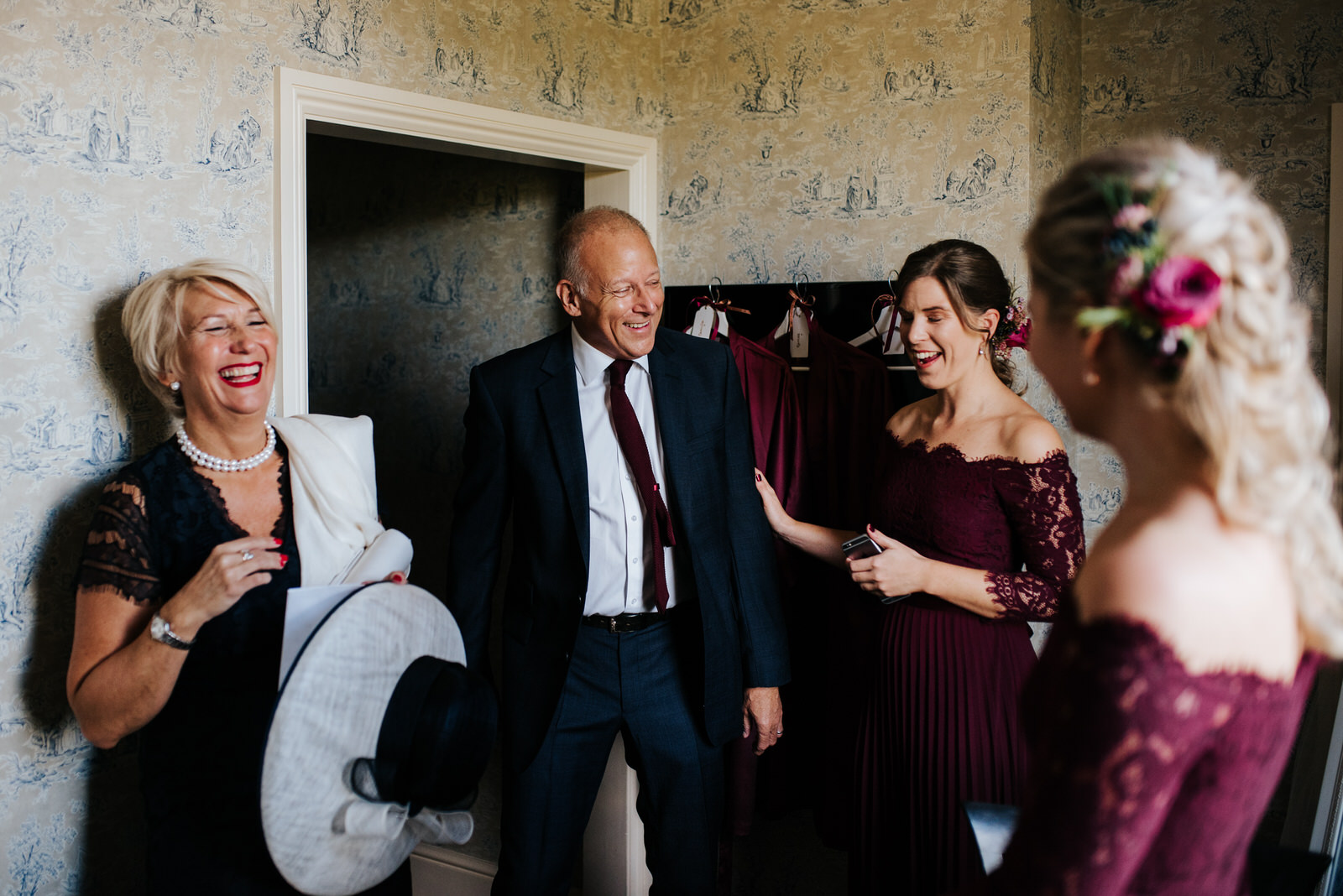 Bride's mom, step-dad and two bridesmaids share a special moment