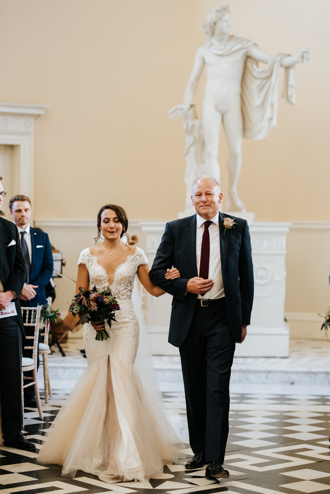 Bride about to start crying as she walks down aisle with step-dad